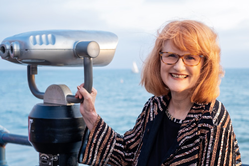 Chellie-on-pier-boat-horizon